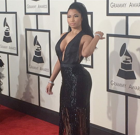 Nicki Minaj Attends The 57th Annual Grammy Awards In A Tom Ford Gown
